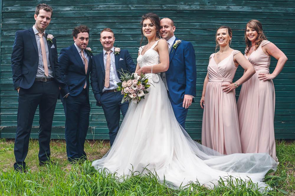 Bride, groom groomsmen and bridesmaids