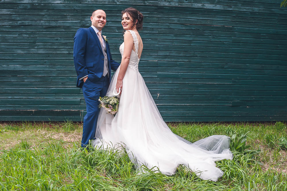 Bride in White dress and groom portrait